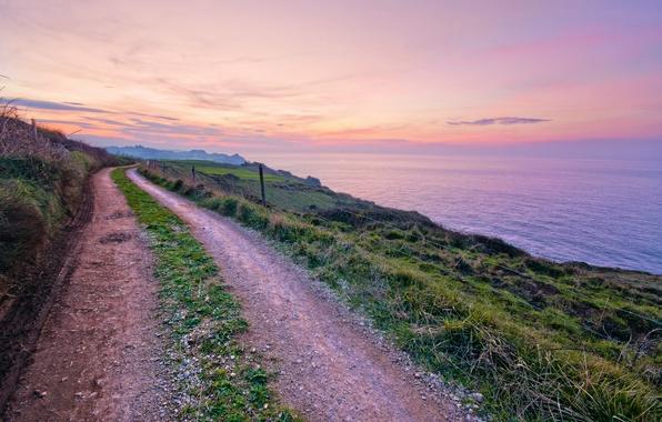 Картинка дорога, море, небо, трава, облака, закат, побережье, вечер, Испания, тропинка