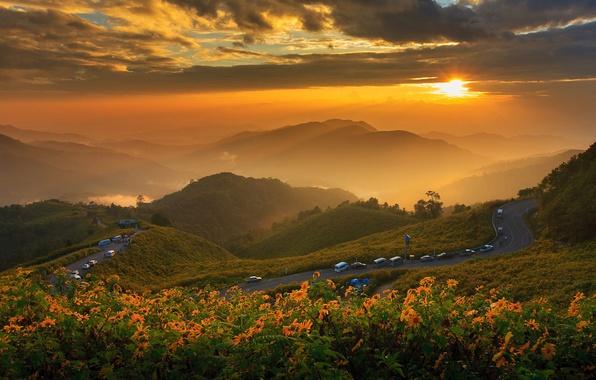 Картинка дорога, солнце, облака, пейзаж, закат, цветы, горы, природа, Таиланд