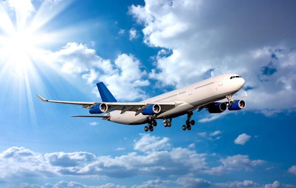 Картинка небо, солнце, облака, лучи, полет, самолет, пассажирский, авиалайнер