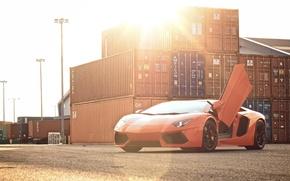 Картинка небо, солнце, оранжевый, lamborghini, блик, вид спереди, контейнеры, orange, aventador, lp700-4, ламборгини, авентадор