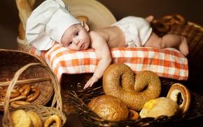 Картинка дети, малыш, хлеб, лежит, бублики, булки, ребёнок, колпак, скатерть, баранки, Анна Леванкова, поварёнок, крендель