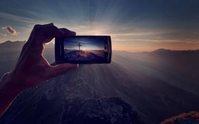 Картинка лучи, свет, горы, природа, рассвет, человек, рука, техника, телефон, мужчина, съемка, электроника, гаджет, смартфон, хай-тек, …