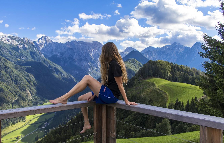 Фото обои лес, лето, небо, девушка, облака, деревья, пейзаж, горы, шорты, высота, долина, Альпы, футболка, шатенка, солнечно, …