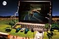 Картинка машины, город, игрушки, динозавр, холм, фонари, ноутбук, кинотеатр, нетбук, gigabyte, модельки, миниатюра