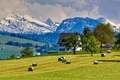 Картинка снег, горы, деревья, коттедж, дом, поле, небо, трава, облака