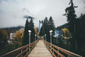 Картинка village, lamp posts, mountains, river, clouds, bridge, peak