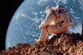Картинка камни, сидит, Земля, астронавт, astronaut, ситуация, Луна, космонавт